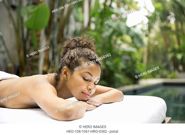 Portrait of relaxed woman on massage table