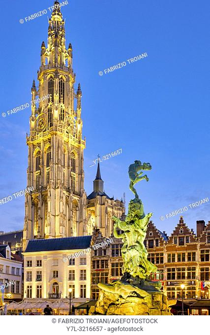 """The Brabo fountain in the Grote Markt (""""""""Great Market Square"""""""") with the belfry of the Cathedral of Our Lady in the background of Antwerp, Belgium"""