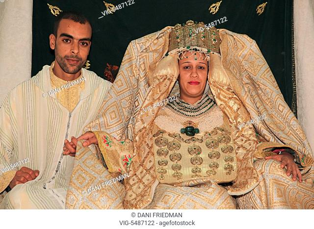 A Moroccan Arab couple dressed in traditional attire during their wedding in Fez (Fes), Morocco, Africa. (This image has a signed model release)