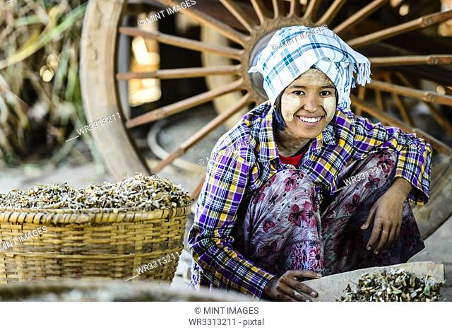Asian girl selling herbs in market