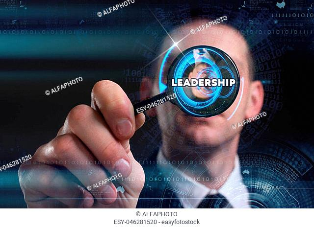 Business, Technology, Internet and network concept. Young businessman working on a virtual screen of the future and sees the inscription: leadership