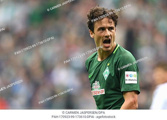 Bremen's Thomas Delaney takes issue with the referee's decision during the German Bundesliga match between Werder Bremen and SC Freiburg at the Weserstadium in...