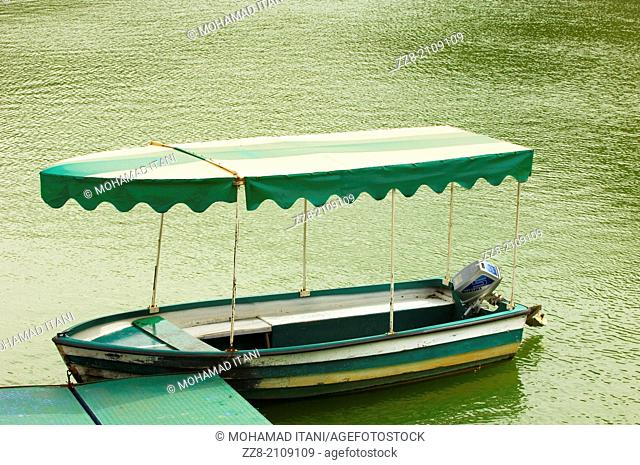 Boat with a cover by the lake wharf
