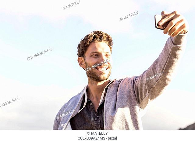 Man taking selfie smiling