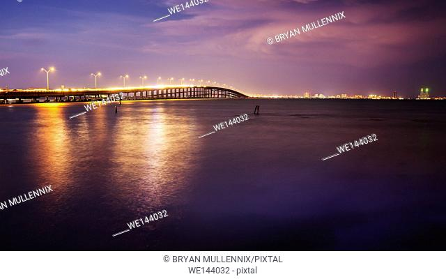 The Queen Isabella Causeway (bridge) leads to South Padre Island, Texas at sunset