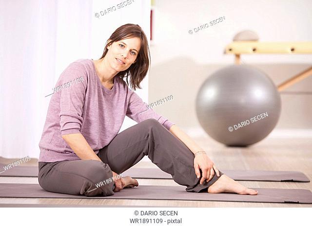 Woman taking a break on Pilates class