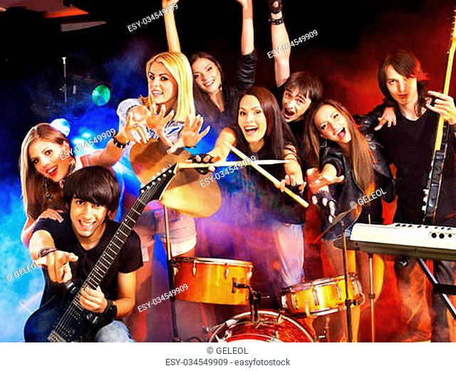 Musical group performance in night club. Lighting effects