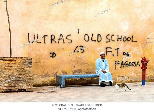 Fes, Morocco, North Africa. An old man with white dress is relaxing