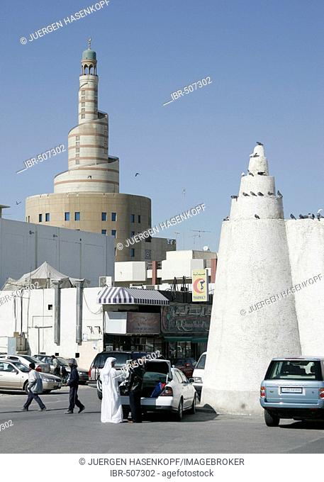 Qatar, Doha, in the front small tower of the Qassim mosque, behind the big tower of the FANAR (Qatar Islamic Cultural Center) building, Arabian architecture