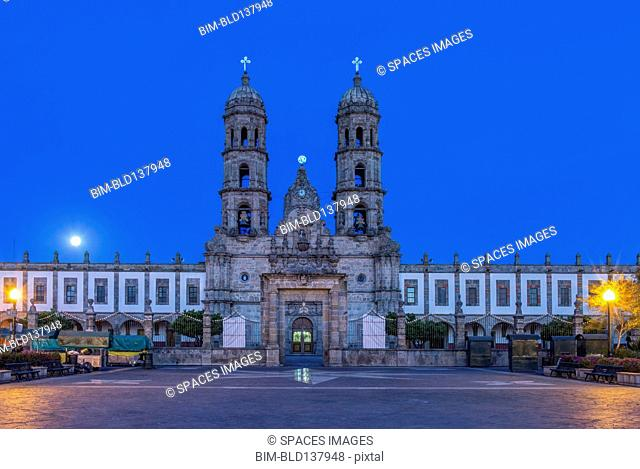 Ornate church overlooking town square at dusk, Zapapan, Jalisco, Mexico