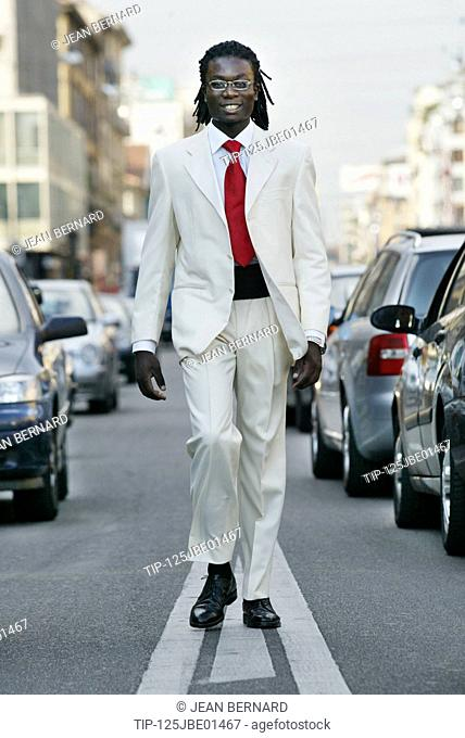 Well dressed afro - american man walking in the street