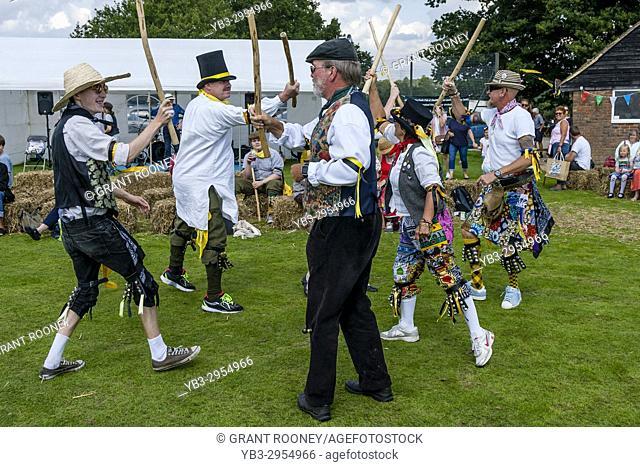 Morris Dancers Performing At The Annual Hartfield Village Fete, Hartfield, East Sussex, UK