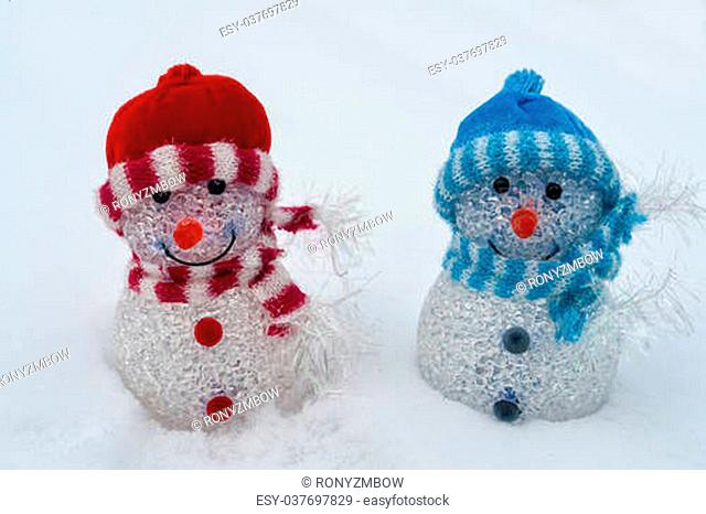 White Christmas - cheerful blue and red snowman on the snow - greeting background