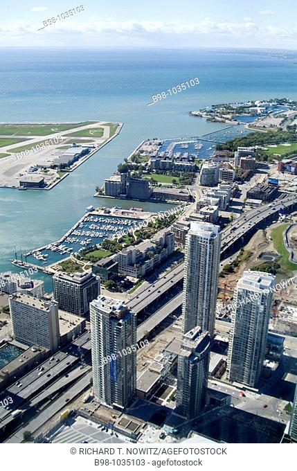 Toronto, Ontario, Canada, view from the observation deck of the CN tower, high rise modern buildings and yacht basin at harbor