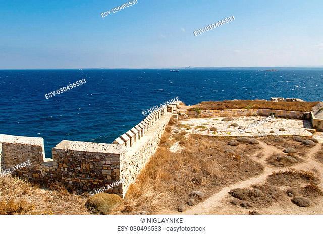 Medieval castle in Tenedos, Bozcaada, Turkey at seacoastline