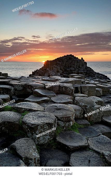 United Kingdom, Northern Ireland, County Antrim, View of causeway coast, Giant's Causeway at sunset