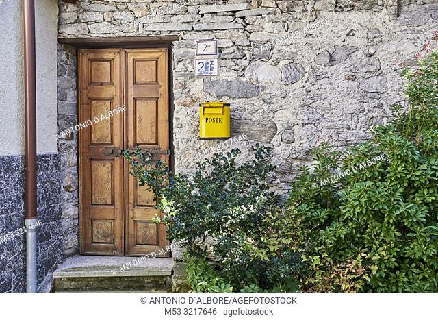 Home entrance in the old town of Craveggia with roofs made of slate rock. Province of Verbano-Cusio-Ossola. Piedmont. Italy