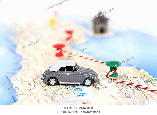 Abstract idea of rent a car. Small car on map. Abstract travel photo