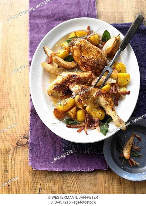 Roast chicken with bacon, pears and potatoes