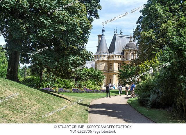Day trippers walking up a path towards waddesdon Manor