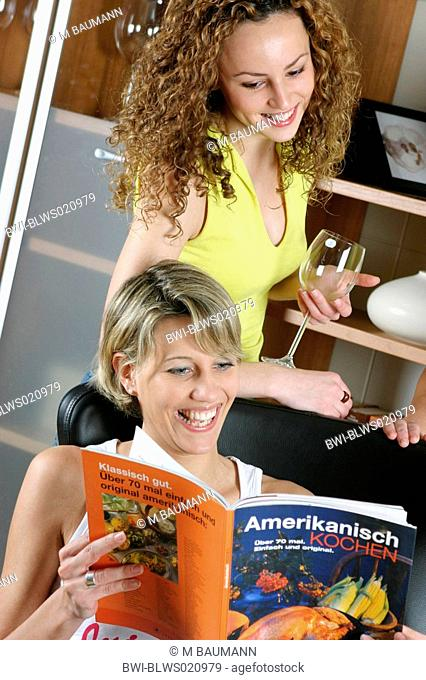 two women with cooking book American cooking
