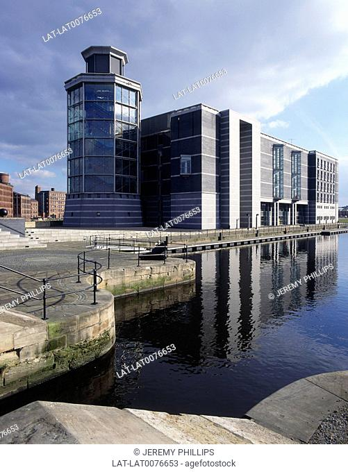 Royal Armouries Building/ museum. Modern. Glass. Octagonal tower. Water. Canal