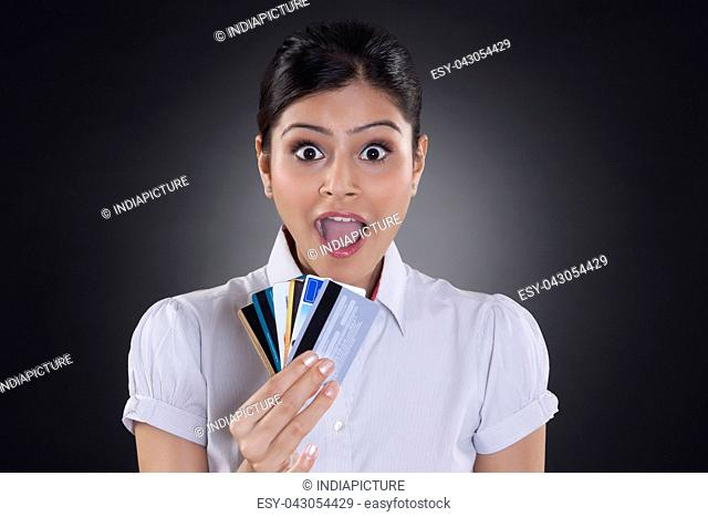 Portrait of businesswoman holding credit cards