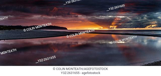 Sunset refection, Three Mile Beach and lagoon, panorama, beyond Okarito, West Coast