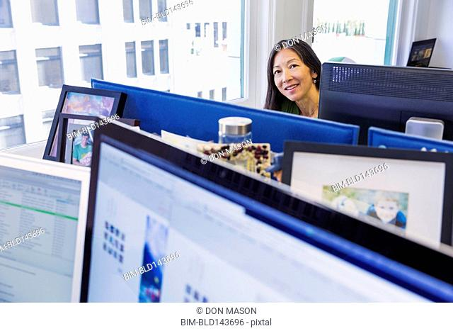 Japanese businesswoman working at computer in office
