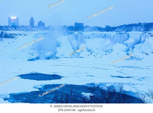 The American Falls almost completely frozen during a cold winter in Niagara Falls, Niagara County, New York, USA