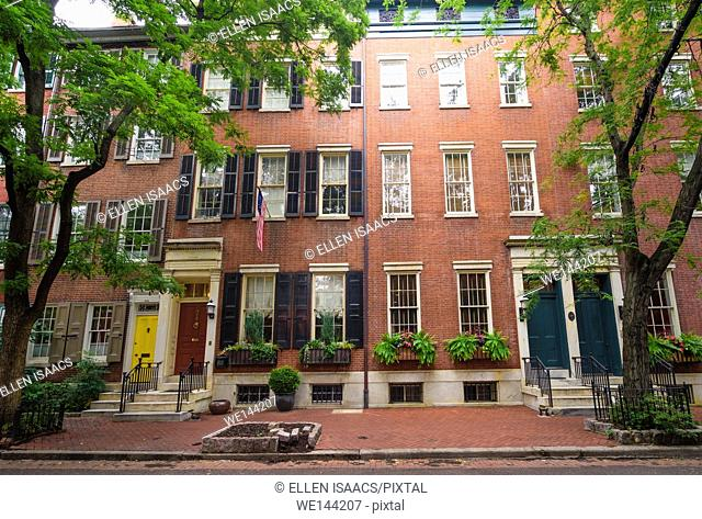 Attractive brick houses decorated with flower boxes in residential neighborhood in Philadelphia