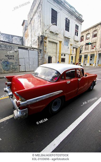 Classic American car driving by Malecon. La Havana. Cuba