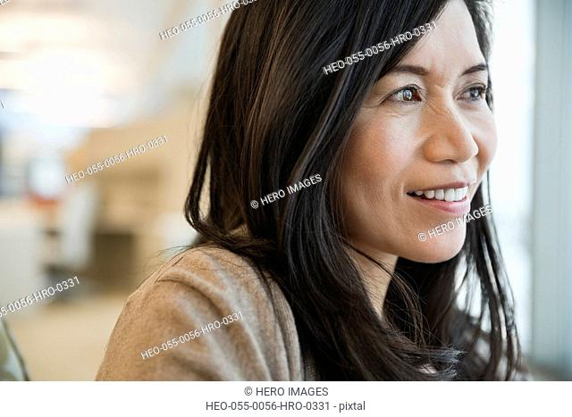 Close-up of thoughtful businesswoman in office