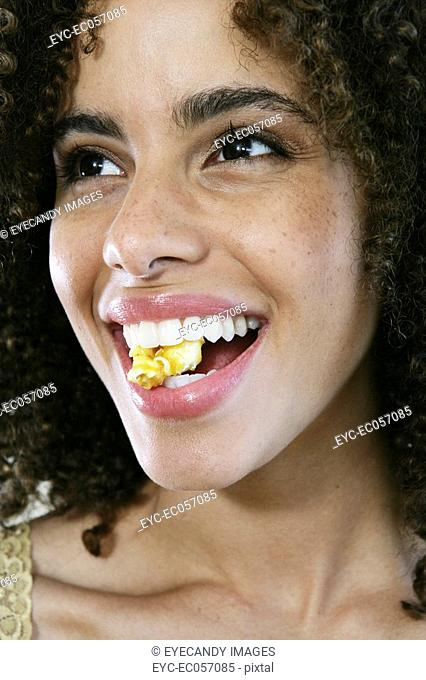 Woman smiling with popcorn between her teeth