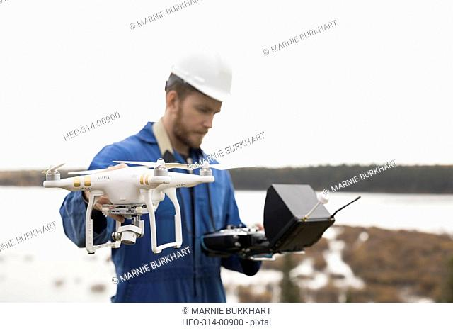 Surveyor with drone equipment at lakeside