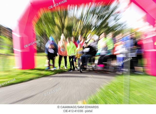 Defocused view of runners ready at charity run starting line