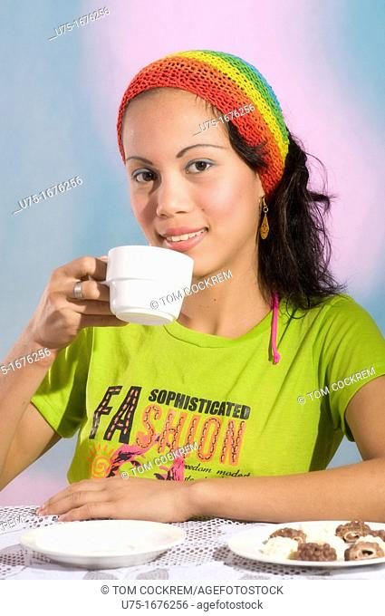 Asian model drinking tea in studio setting
