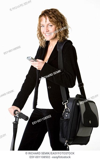 businesswoman with mobile phone and notebook