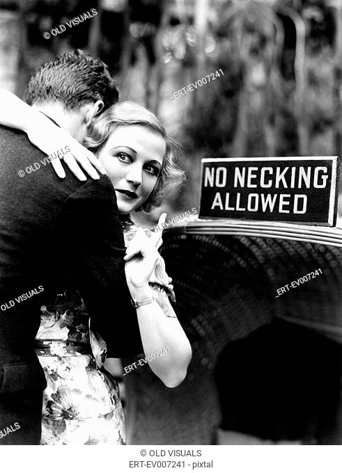 Young woman embracing a man and pointing towards an information board All persons depicted are not longer living and no estate exists Supplier warranties that...