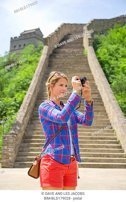 Caucasian woman photographing Great Wall of China, Beijing, Hebei Province, China