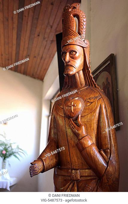 Wooden carving of Jesus Christ in the church in the small town of Hanga Roa, Easter Island, Chile. The carving features symbolism from both Roman Catholicism as...