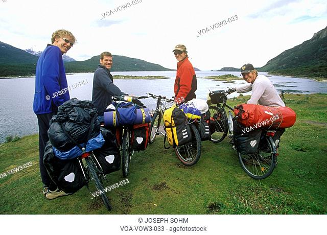 Cross country bicyclists in Andes Mountains, Tierra del Fuego National Park, Ushuaia, Argentina