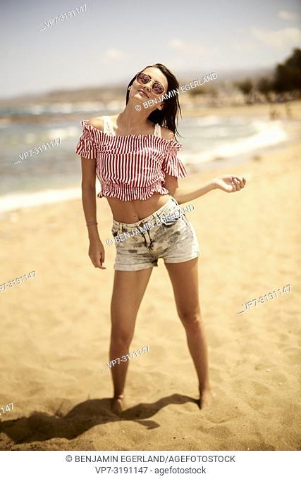 Portrait of woman at the beach. Crete, Greece