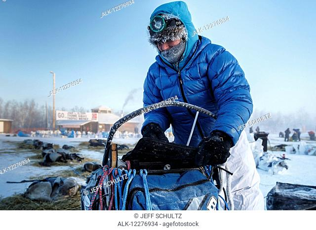 Paige Drobny packs her sled in the morning at the Huslia checkpoint during Iditarod 2015