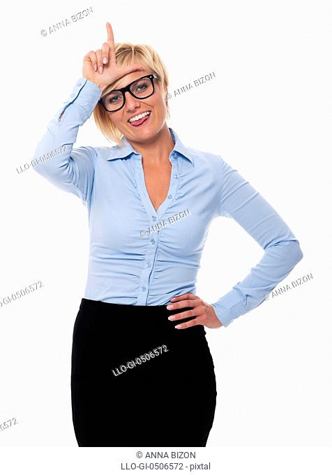 Funny businesswoman showing loser sign, Debica, Poland