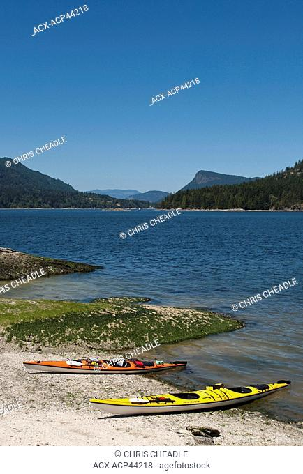 Kayaks on Russell Island with view to Fulford Harbour, Saltspring Island, British Columbia, Canada
