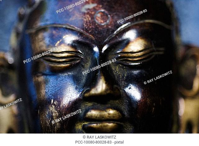 Close-up on the face of a Buddha sculpture