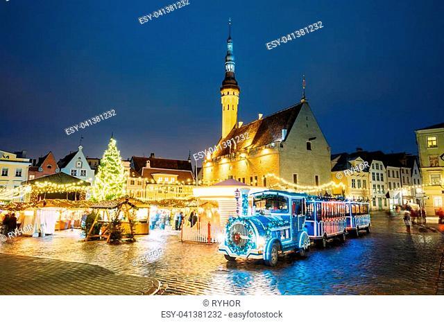 Tallinn, Estonia. Beautiful Train For Sightseeing Near Traditional Christmas Market On Town Hall Square - Raekoja Plats. Christmas Tree And Trading Houses