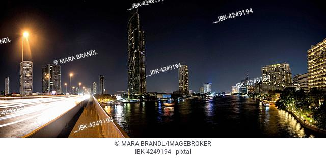 Skyline, bridge over Chao Phraya River at night, Bangkok, Thailand