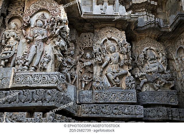 Sculpture of Bhairava on the left, Shiva in the centre and Narsimha on the right, west side walls, Hoysaleshwara temple, Halebidu, Karnataka, india